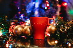 Cup of tasty hot cocoa, on wooden table, with shiny background Stock Photos