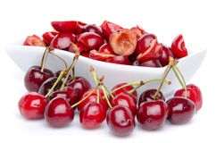 Cup of tasty pitted cherries with whole cherries Royalty Free Stock Photography