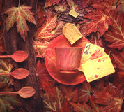 Cup of tea. Playing cards,  and autumn leaves Stock Images