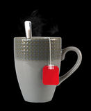 Cup of tea. With smoke over isolated on black Royalty Free Stock Photography