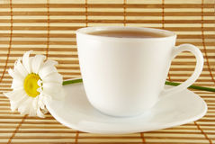A cup of tea. With white daisy stock photos