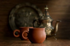 Cup of tea. The Arabian silver teapot on a dark background Royalty Free Stock Photography