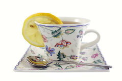 Cup of tea. With spoon and slice of lemon Stock Image