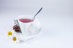 Cup of tea. With flowers and cinnamon with space for text Royalty Free Stock Photo