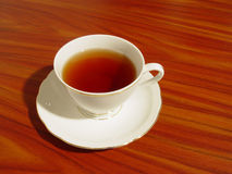 A cup of tea. & wood texture stock image