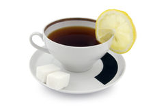 Cup of tea. A cup of tea with sugar cubes and lemon slice. Clipping path included Stock Images