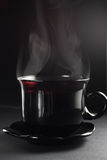 Cup of tea. On the dark background Royalty Free Stock Images