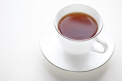 Cup of Tea. A cup of warm tea on white background. Plenty of copy space Royalty Free Stock Image