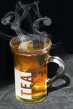 Cup of tea. Hot cup of tea with tea bag and spoon Royalty Free Stock Image