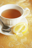 Cup of tea. With spoon and slice of lemon stock photography