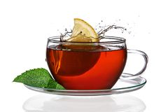 Cup of tea. Concept with lemon and splash royalty free stock image