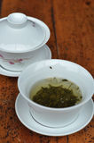 Cup of tea. Chinese teacup and jasmine tea royalty free stock photos