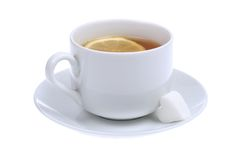 Cup of tea. With lemon and heartshaped sugar cube isolated on white background Stock Photo