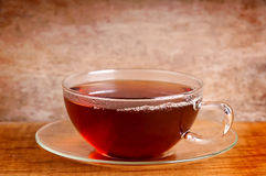 Cup of tea. On a wooden vintage background royalty free stock photo