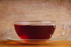 Cup of tea. On a wooden background royalty free stock image