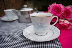 Cup of tea. Cup and saucer on table with tea things Royalty Free Stock Images