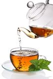 Cup of tea. Tea poured into glass tea cup (clipping path included