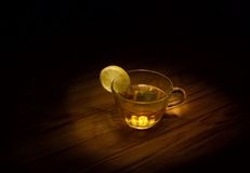 Cup of tea. Still life - cup of tea with lemon (low-key image stock image