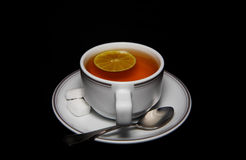 Cup of tea. View of cup of nice hot tea with lemon and sugar stock images