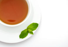 Cup of tea. Close-up cup of tea with mint leaves over white background Stock Photo