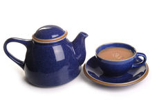 Cup of tea. Photograph of a cup of tea and tea pot shot in studio against a white background Stock Photos