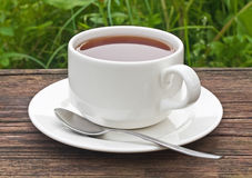 Cup of tea. On the old wooden table Stock Photo