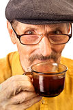 A cup of tea. The old man with cup of tea Stock Photography
