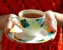 Cup of tea. In hands of woman Royalty Free Stock Photos