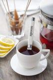 Cup of tea. Lemon, brown sugar on a stick Stock Photo