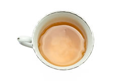 A Cup of Tea. A white cup of golden English tea with the white background Royalty Free Stock Photos