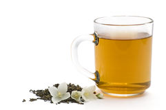 Cup of tea. Tea leaves and jasmin on white royalty free stock photo