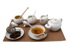 Cup of tea. Cup of black tea with pot, honey, milk and sugar Stock Photo