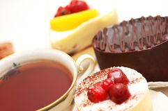 Cup of tea. And various fruit cakes Royalty Free Stock Photos