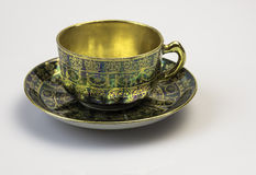 Cup of tea. The historic, decorated porcelain cup for drinking tea Stock Photo