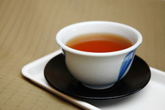 Cup of Tea. A cup of chinese tea on a brown background stock photos