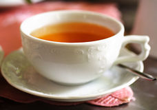 Cup of tea. In white dishes stock photography