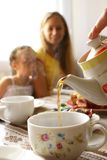 Cup of tea. Sisters behind morning tea drinking Royalty Free Stock Photo