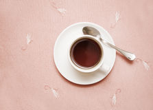 Cup of tea. Just cup of tea in a centre of pictures on the tablecloth royalty free stock photo