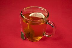 Cup of Tea. On Red Background Stock Photos