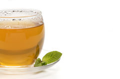 A cup of tea. Close-up of a cup of tea with a mint leaf royalty free stock photography