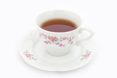 Cup of tea. Tea in china cup with decorations royalty free stock image