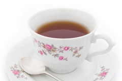 Cup of tea. Tea in china cup with decorations royalty free stock photos