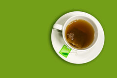 Cup of tea. On green background Stock Photos