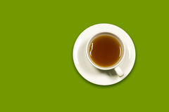 Cup of tea. On green background Stock Photo