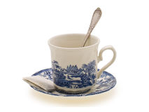 A cup of tea. English porcelain cup of tea with a spoon on a white background Stock Photo