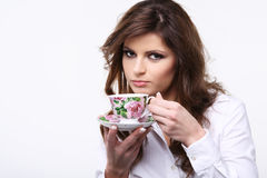 Cup of tea. Beautiful young woman with cup of tea royalty free stock photo