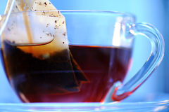 Cup of tea. On a blue background close up Royalty Free Stock Photo
