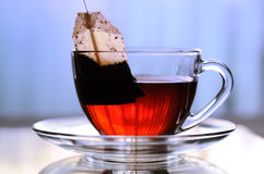 Cup of tea. On the glass table Royalty Free Stock Images