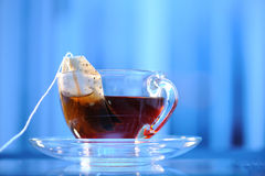 Cup of tea. On a blue background Royalty Free Stock Photo