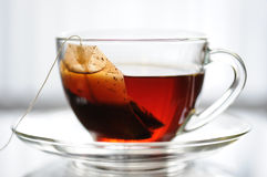 Cup of tea. On a table, white background - close up Royalty Free Stock Photo